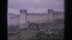 1966: castle on mountain has flat walls, circular towers Stock Footage