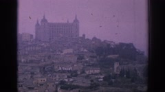 1966: view from the distance of a small town with large and small buildings Stock Footage