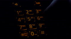 Dialing 911 emergency call nightime Stock Footage
