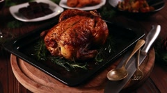 Roasted whole chicken and other side dishes for festive dinner christmas new  Stock Footage