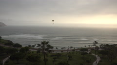 Lima Miraflores Paraglider Pacific Ocean at Sunset Stock Footage