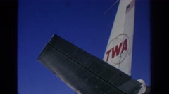 1966: people getting into a plane, vintage clip of TWA plane Stock Footage