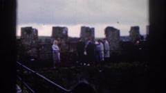 1961: the group of men walked along the bridge as steady as possible. DUBLIN Stock Footage