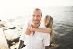 Fashion model couple with tattoo posing outside nea sea Stock Photos