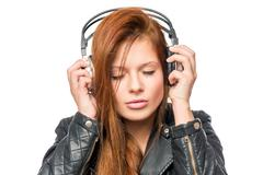 Lover of music enjoying the melody with headphones, portrait on a white backg Stock Photos