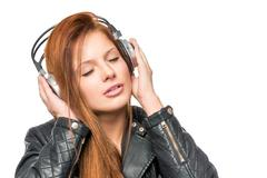 Girl enjoying a classic melody with headphones, portrait on a white backgroun Stock Photos