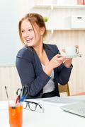A cup of coffee to feel good during working hours at the office Stock Photos