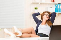 Despising conventions business woman relaxing in the office with his feet on  Stock Photos