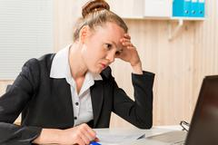 Disappointed woman looking for a Financial Analyst error reports Stock Photos