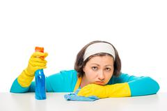 Portrait of a woman, tired of household chores on a white background Stock Photos