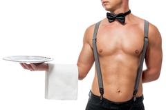Strong hand of sexual stripper holding a tray Stock Photos