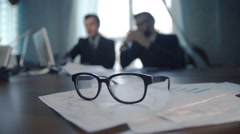 Businessman meeting to discuss in office seen by unfocused glasses Stock Footage