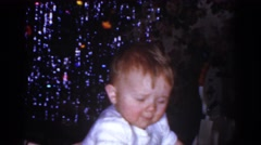 1968: little baby being pushed on his toy car. OMAHA NEBRASKA Stock Footage