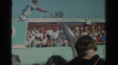 1971: dolphins having a wonderful time, jumping up to their trainer  Stock Footage