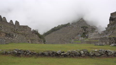 Low Angle Machu Picchu Village In Fog Stock Footage