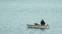Lonely man on a boat Stock Footage