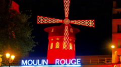 4K Windmill and Moulin Rouge Sign, Famous Nightlife Paris Landmark, France Stock Footage