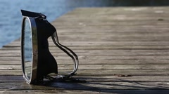 Diving mask at the edge of the water bridge. Stock Footage