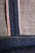 Close up of denim jeans red selvedge texture. Stock Photos