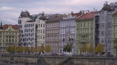 Riverside Vltava in Prague with dancing house in evening autumn. Stock Footage