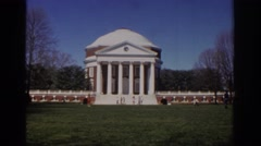1971: little kid running and playing in front of a government building. RICHMOND Stock Footage