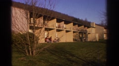 1971: a large building having a vast meadow in the yard near to a mountain Stock Footage