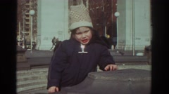 1971: young child playing outdoors near cement pillar BEDFORD VIRGINIA Stock Footage