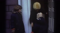 1971: woman and two kids get out of a house and wave at the camera BEDFORD Stock Footage