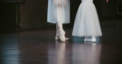Adult ballerina teaching a little girl, classical ballet in the loft Studio Stock Footage