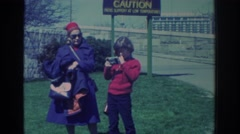 1971: a mom and child visit the falls NIAGARA FALLS NEW YORK Stock Footage