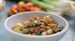 Man sprinkle green onion and red chili on beef and vegetable curry stew Stock Footage