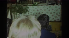 1972: the whole family gathered in the living room for a puppet show TORONTO Stock Footage