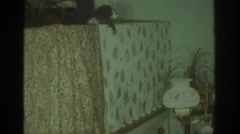 1972: toy possum nodding 'hello' in a dark room. there is something eerie  Stock Footage
