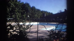 1972: lonely sight of a not so busy swimming pool. TORONTO CANADA Stock Footage