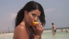 Sexy girl eats an orange sensuality Stock Footage