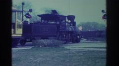 1972: steamer engine hauls passenger cars through town. TORONTO CANADA Stock Footage