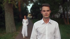 The first meeting of the groom and the bride in park Stock Footage