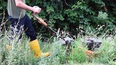 Gardener cutting the grass Stock Footage