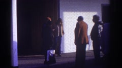 1976: some folks standing around outside a building WATKINS GLEN NEW YORK Stock Footage
