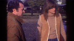 1976: couple and man in tan all discuss car issue WATKINS GLEN NEW YORK Stock Footage
