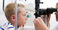 Optometrist examining patient on slit lamp Stock Footage