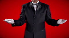 4K Tuxedo Man and Red Background, White Gloves Open Hand Reveal Stock Footage