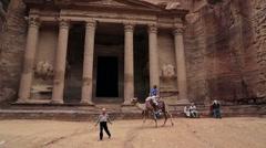 Woman tourist riding on his camel in Petra Jordan Stock Footage