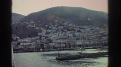 1976: a ship slowly and gradually returning to it's port of call on an overcast Stock Footage