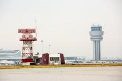Airport control tower and radar communication tower Stock Photos