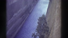 1976: a deep, windy ship channel below a white, trestle bridge GREECE Stock Footage