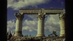 1976: three ancient stone columns holding up two beams GREECE Stock Footage