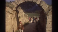 1976: classic keystone archway bridge holding up ancient stone wall Stock Footage
