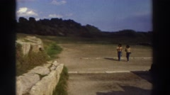 1976: visitors walking to and fro in a national park. GREECE Stock Footage
