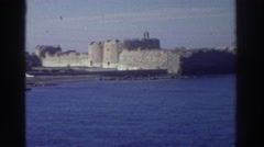 1976: castle along the sea, seen from a boat, clear sunny day GREECE Stock Footage